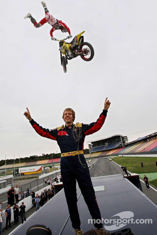 Red Bull X-Fighters Demo Show: Busty Wolter jumps over Sebastian Vettel, Scuderia Toro Rosso standing on a Toro Rosso Truck