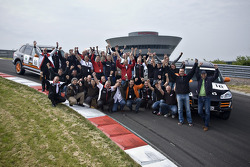 Porsche Motorsport drivers, co-drivers and team members pose during the Porsche training event in Leipzig