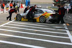 Audi mechanics push the car of Oliver Jarvis, Audi Sport Team Phoenix, Audi A4 DTM, into the pitbox