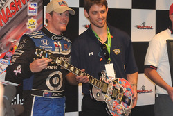 Victory lane: Scott Dixon receives his guitar