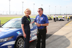 Mrs. McCain gets a pace car ride with Johnny Rutherford
