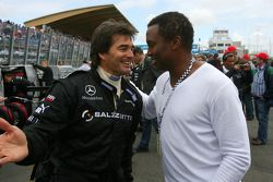 Pop singer Haddaway on the grid chatting with a Mercedes mechanic