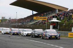 Start: Mattias Ekström, Audi Sport Team Abt Sportsline, Audi A4 DTM, leads Timo Scheider, Audi Sport