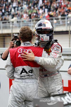 Race winner Mattias Ekström celebrates with Tom Kristensen