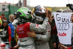 Race winner Mattias Ekström celebrates with Timo Scheider