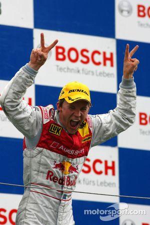 Podium: race winner Mattias Ekström celebrates
