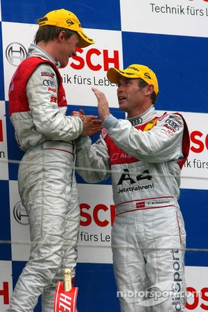 Podium: race winner Mattias Ekström celebrates with Tom Kristensen