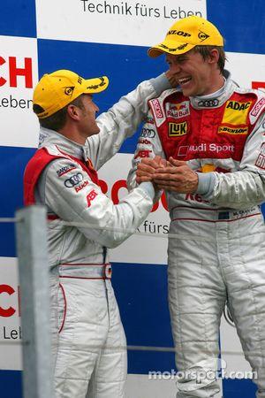 Podium: race winner Mattias Ekström celebrates with Timo Scheider