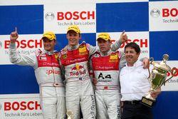 Podium: race winner Mattias Ekström, second place Timo Scheider, third place Tom Kristensen