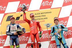 Podio: il vincitore della gara Casey Stoner con Valentino Rossi e Chris Vermeulen