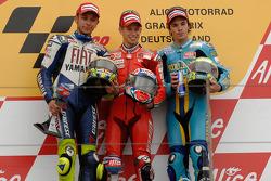 Podio: ganador de la carrera Casey Stoner, Valentino Rossi el segundo lugar y tercer lugar Chris Ver