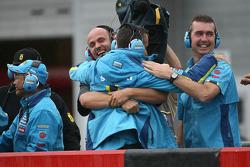 Suzuki team members celebrate third place of Chris Vermeulen