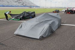 Cars are covered as rain starts to fall