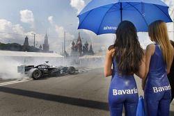 The charming Bavaria girls look on as Nico Rosberg starts