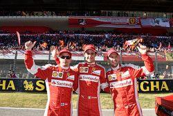 Les pilotes Ferrari F1 Sebastian Vettel, Kimi Raikkonen et Esteban Gutierrez, pilote d'essais et de réserve Ferrari