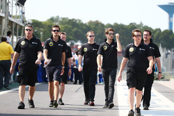Jolyon Palmer, Lotus F1 Team Test and Reserve Driver and Romain Grosjean, Lotus F1 Team walk the circuit with the team