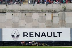 Pastor Maldonado, Lotus F1 E23 passes a Renault advertising hoarding