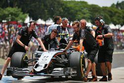 Sahara Force India F1 Team mechanics push the Sahara Force India F1 VJM08 of Sergio Perez,