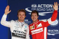 Il Poleman Nico Rosberg, Mercedes AMG F1 W06 e il terzo qualificato Sebastian Vettel, Ferrari SF15-T