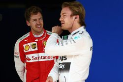 Third place Sebastian Vettel, Ferrari SF15-T and polesitter Nico Rosberg, Mercedes AMG F1 W07