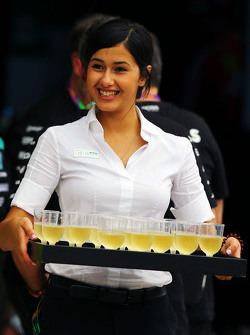 Mercedes AMG F1 offer drinks in the paddock