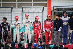 Drivers on the starting grid with the fans