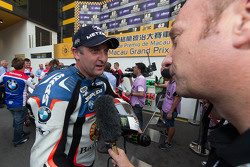 Third place Michael Rutter with the media