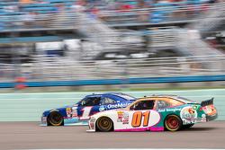 Landon Cassill, JD Motorsports Chevrolet and Elliott Sadler, Roush Fenway Racing Ford