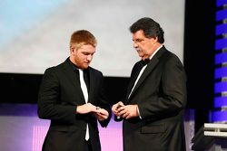2015 NASCAR Xfinity Series champion Chris Buescher with NASCAR Vice-Chairman Mike Helton