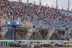 Restart: Kyle Larson, HScott Motorsports with Chip Ganassi and Kyle Busch, Joe Gibbs Racing Toyota battle for the lead