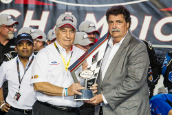 Championship victory lane: NASCAR XFINITY Series 2015 champion owner Roger Penske, Team Penske Ford, with NASCAR President Mike Helton