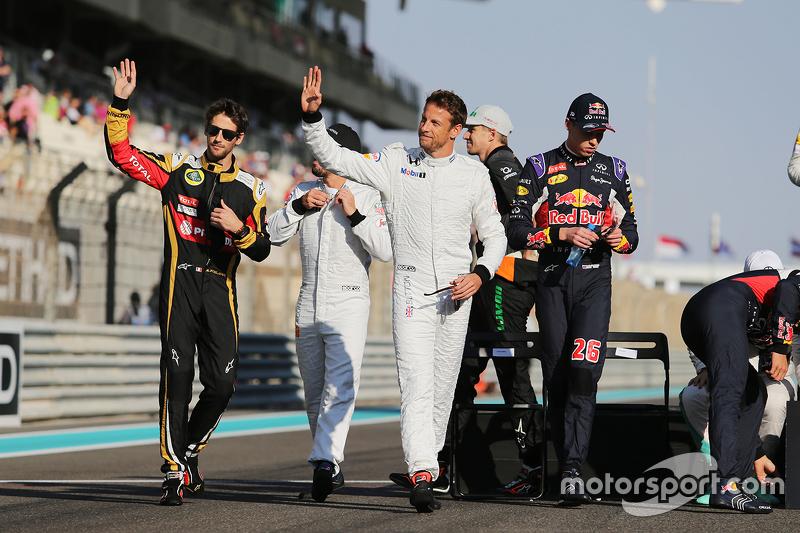 Jenson Button, McLaren, und Romain Grosjean, Lotus F1 Team, bei der Fahrerparade