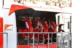 Ferrari team members on the pit wall