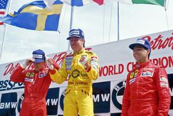Podium: race winner Keke Rosberg, Williams, second place Stefan Johansson, Ferrari, third place Michele Alboreto, Ferrari