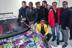 Ben Levy with Tyson Beckford, Steve Hawthorne, Neil Handler and friends pose with the Ferrari F430