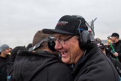 Flying Lizard Motorsports team members celebrate the win