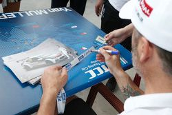 Yvan Muller, Citroën World Touring signs autograph for the fans