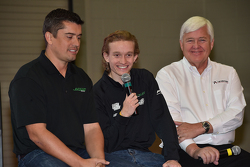 Garrett Grist speaks at the PRI show, flanked by Ricardo Juncos and Dan Andersen