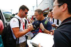 Jose Maria Lopez, Citroën World Touring Car team signs autographs for the fans