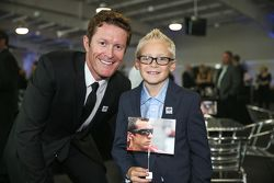 Scott Dixon with a young Justin Wilson fan