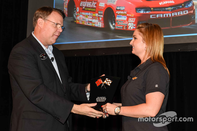 Erica Enders is given an award from General Motors Vice President Motorsports and Performance Vehicl