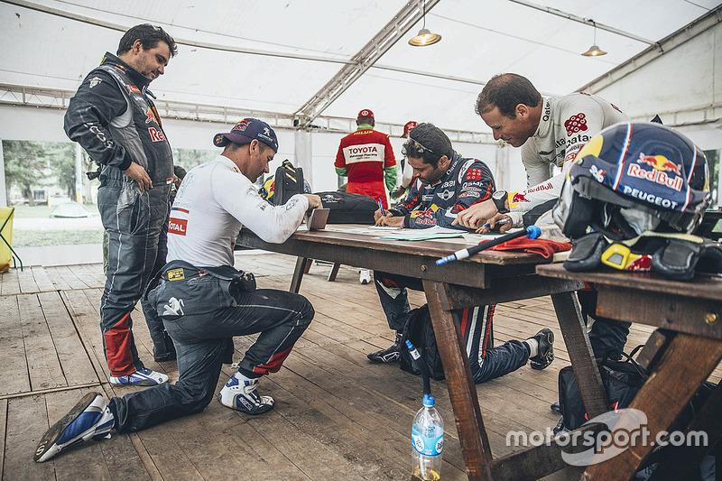 Passport control for Sébastien Loeb, Daniel Elena, Nasser Al-Attiyah and Matthieu Baumel