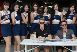 Nicolas Leutwiler and Oliver Webb with grid girls