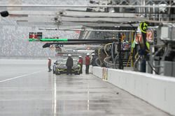Cars on pit lane during a huge downpour