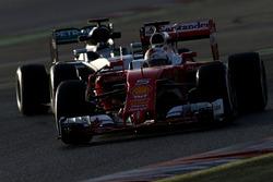 Sebastian Vettel, Scuderia Ferrari e Nico Rosberg, Mercedes AMG F1 Team