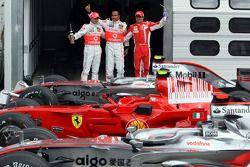 Pole winner Lewis Hamilton with Felipe Massa and Heikki Kovalainen