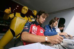 Luca Filippi, Andy Soucek and Kamui Kobayashi sign autographs for fans