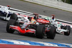 Lewis Hamilton, McLaren Mercedes, MP4-23 leads Rubens Barrichello, Honda Racing F1 Team, RA108