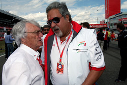 Bernie Ecclestone, President and CEO of Formula One Management with vJohn McQuilliam, Force India F1 Team, Chief Designer