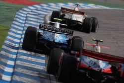 Lucas di Grassi leads Pastor Maldonado and Bruno Senna